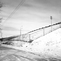 Fenced Embankment on Hiawatha Ave (Hwy 55) near Franklin Ave, Minneapolis. March 1976